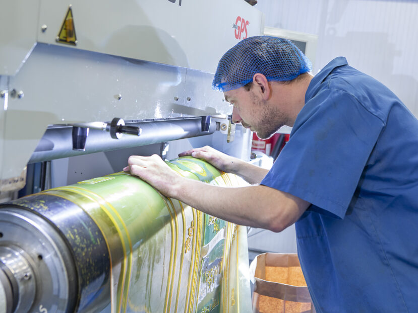 Team member operating the printing machine
